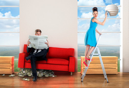 Man sitting on a  money pile while woman is doing chores