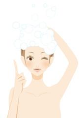 ポイント シャンプーをする笑顔の女性