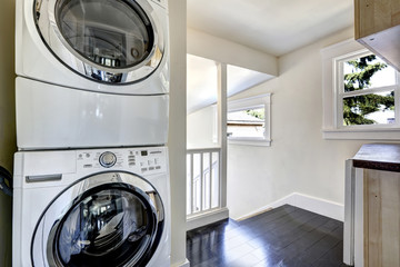 Laundry area with modern white appliances