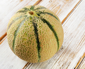 Whole melon  on a wooden background