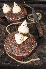 Chocolate pumpkin cupcakes, decorated with meringue ghosts