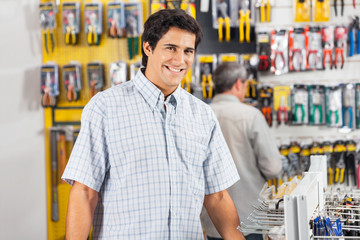 Male Customer Buying Tools At Hardware Store