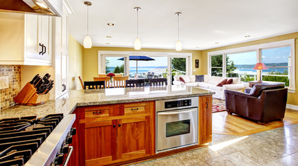 Bright house interior. Living room with walkout deck and kitchen