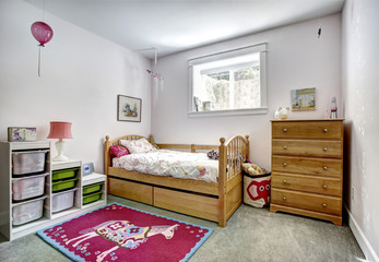 Kids room interior with storage baskets for toys