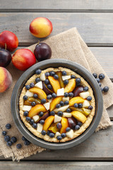 Tart with peach, pumpkin, plum, pear and blueberry in autumn set