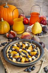 Tart with peach, pumpkin, plum, pear and blueberry in autumn set