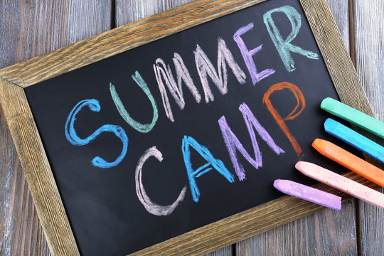Text Summer camp written with chalk