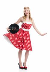 Tanzende Frau hält eine Schallplatte