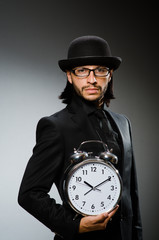 Man with clock wearing vintage hat
