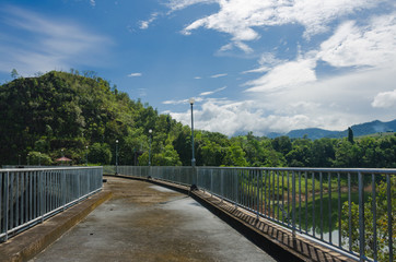 pathway on top of dam for overlooking the water and mountains