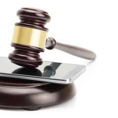 Smartphone between judge gavel and soundboard - 1 to 1 ratio