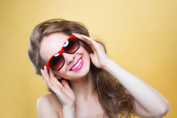 young beautiful girl in black glasses smiling