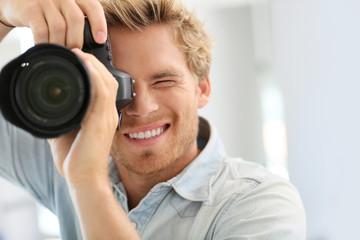 Fashion photographer shooting model in studio