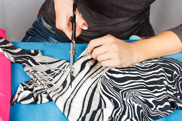hands of a seamstress at work.
