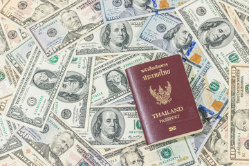 Bank notes in U.S. currency with passport of Thailand for travel