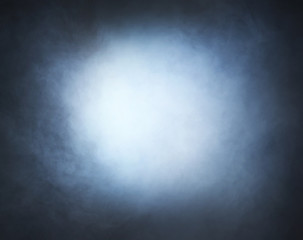 Light blue smoke over black background