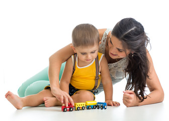 kid boy and his mom play with toy