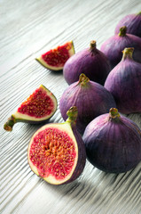 Portion of fresh Figs on wooden background
