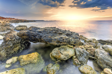 surreal landscape heap of stones in the sea shot with a long exp