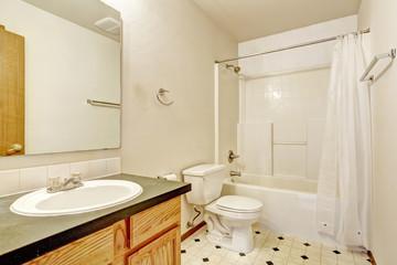 Simple bathroom interior with linoleum floor