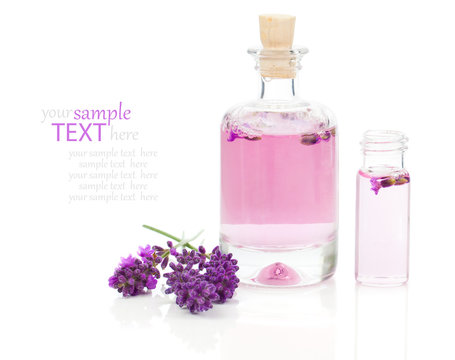 fresh lavender blossoms with Natural handmade lavender oil, on w
