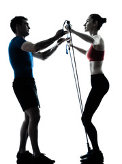 Wall Mural - coach man woman exercising gymstick silhouette