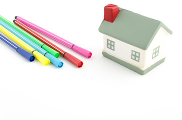 toy house with felt pens isolated on white