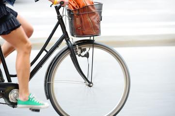 Fototapete - Side shot of woman on bike