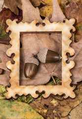 wooden picture frame on autumn leaves