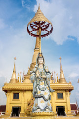 Guan Yin statue with blue sky, Thailand