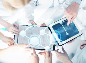 group of doctors with tablet pc and clipboard