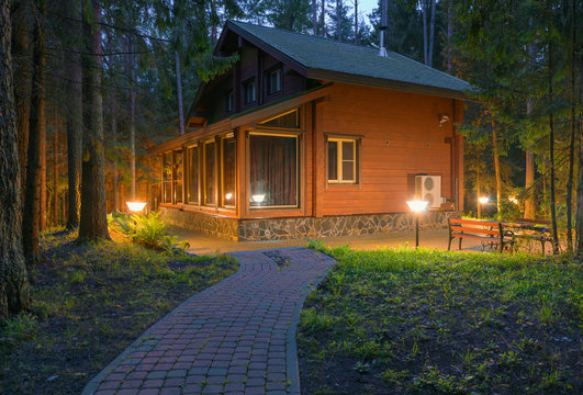Wooden house illuminated at night