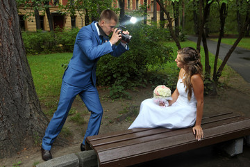 Wedding photo shoot, a newlywed with a camera, take pictures bri