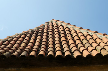 old tile roof on blue sky