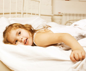 portrait of little cute girl in bed