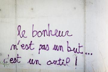 Graffiti phrase sur le bonheur