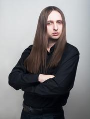 Serious man in black shirt