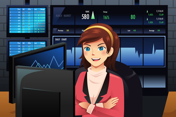 Stock trader in front of multiple monitors
