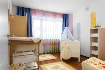 Kinderzimmer mit Babywiege