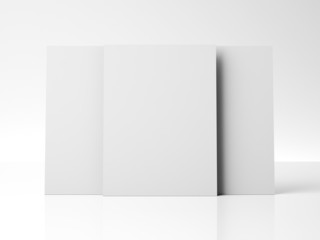 three blank posters on white wall