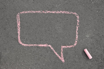 chalk painting speech bubble on the street