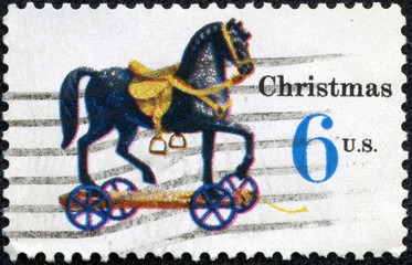 stamp printed in the USA shows Toy Horse on Wheels