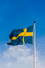 Swedish flag waving in the wind.