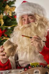Santa Claus making new toys