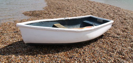 A Small Rowing Boat on a Shingle Bank.