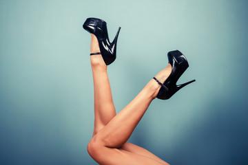 Sexy female legs in high heels Wall mural