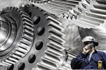 Wall Mural - engineer, worker with cogwheels machinery, steel and titanium