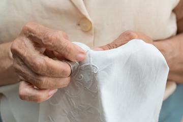 Senior woman sewing