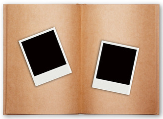 two polaroid frame with old book open