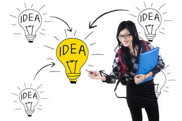Student drawing lightbulb symbolizing idea